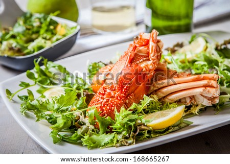 boiled lobster with salad and wine cup - stock photo