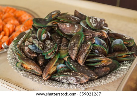 Boiled mussels on the plate - stock photo