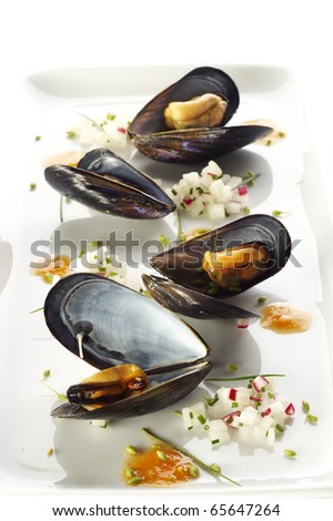 Boiled mussels on white plate - stock photo