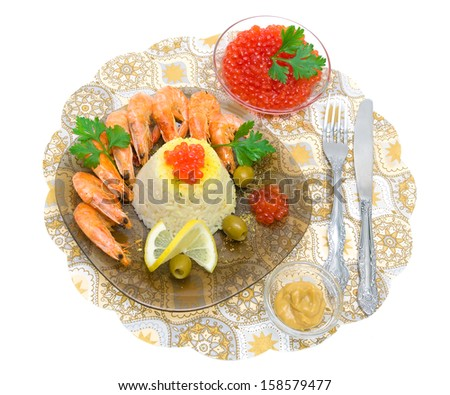boiled rice, fried shrimp, lemon, olives and red caviar on a plate on a white background. top view - horizontal photo. - stock photo