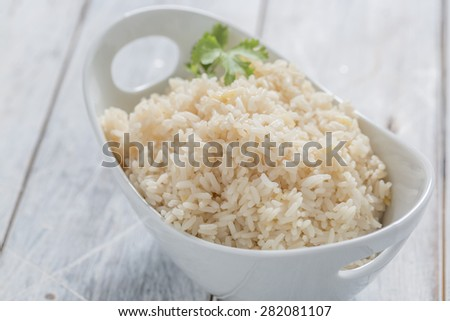Boiled Rice in a bowl on a white table - stock photo