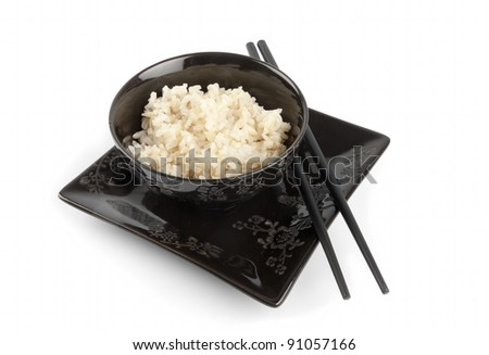 Boiled rice in a ceramic bowl and chopsticks isolated on white - stock photo