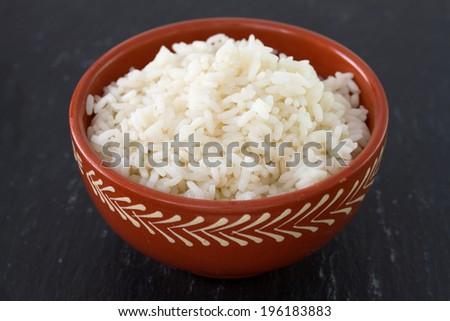 boiled rice in ceramic bowl - stock photo