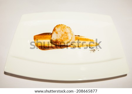 boiled scallop with truffle sauce - stock photo