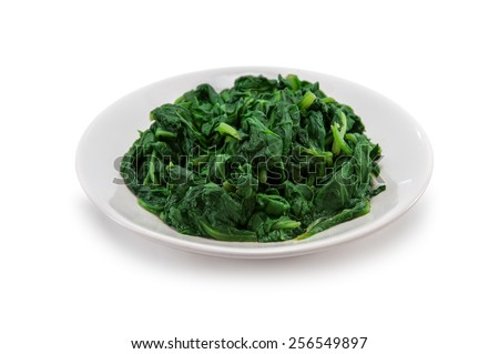 boiled spinach on plate isolated - stock photo