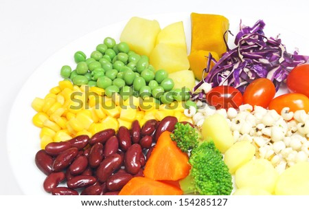 Boiled vegetables and boiled grains salad in a dish - stock photo