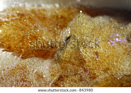 Boiling oil in a deep fryer. - stock photo