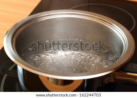 Boiling water. Candied Orange Zest Cooking. Series. - stock photo