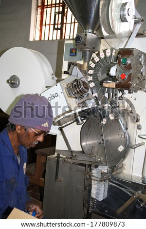 BOIS CHERY, MAURITIUS - OCTOBER 28: Unidentified men controlling production of tea bags, October 28, 2013 in Bois Chery, Mauritius. - stock photo