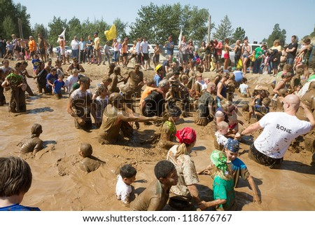 BOISE, IDAHO - AUGUST 25: People play in the pond of mud at the Dirty Dash August 25 2012 in Boise, Idaho - stock photo
