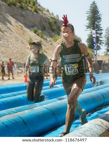 BOISE, IDAHO - AUGUST 25: Unidentified people run down the slides at the Dirty Dash August 25 2012 in Boise, Idaho - stock photo