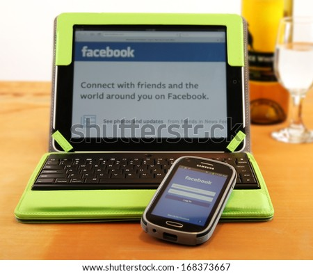 BOISE, IDAHO - DECEMBER 21, 2013: Checking Facebook is easy with mobile apps for tablets and cell phones - stock photo