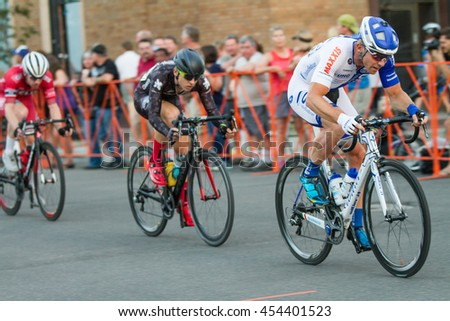 BOISE, IDAHO-JULY 16 2016: Racers trying to beat each other at the boise twilight crterium - stock photo