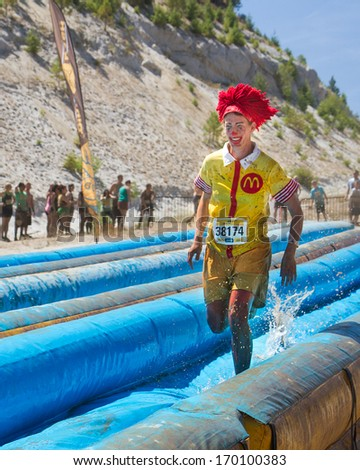 BOISE, IDAHO/USA - AUGUST 10, 2013: Runner 38174 dressed as Ronald Mcdonald the Mcdonalds mascot at the The Dirty Dash - stock photo