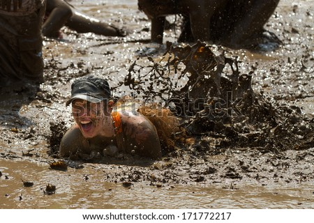 BOISE, IDAHO/USA - AUGUST 11, 2013: Unidentified person makes a mess in the mud pit after falling at the dirty dash - stock photo