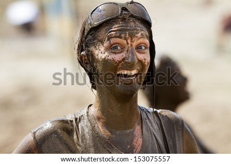 BOISE, IDAHO/USA - AUGUST 11:Unidentified woman gives the camera a huge grin at the The Dirty Dash in Boise, Idaho on August 11, 2013  - stock photo