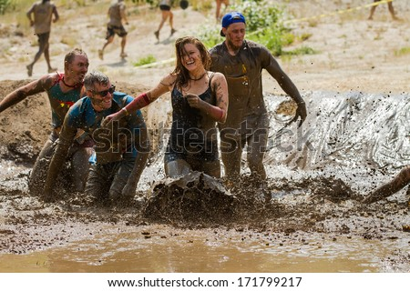 BOISE, IDAHO/USA - AUGUST 11, 2013:  Unidentified woman makes a final dash to the finish at the dirty dash - stock photo