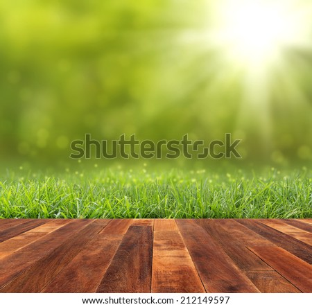 bokeh and sunlight with wood floor  - stock photo