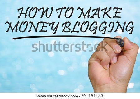 bokeh background and hand writing how to make money blogging. - stock photo