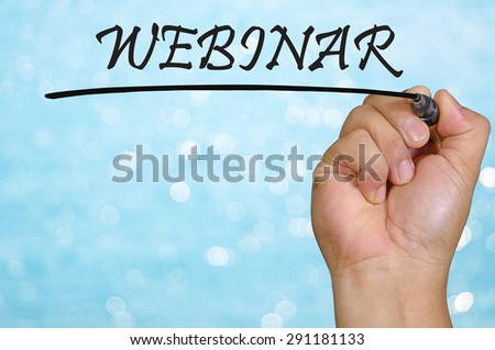 bokeh background and hand writing webinar. - stock photo
