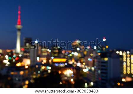 Bokeh background of Auckland financial center skyline at night in Auckland, New Zealand. - stock photo
