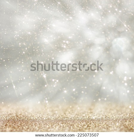 bokeh lights background with colors of white silver and gold texture with motion blur  - stock photo