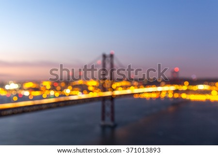 Bokeh lights (defocused image) of a bridge in Lisbon, Portugal. - stock photo