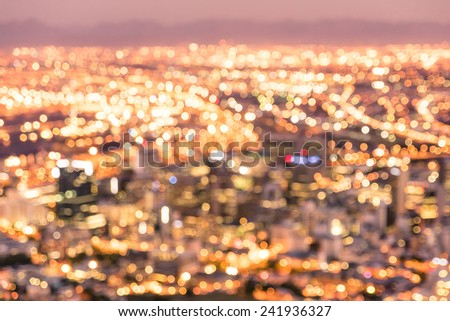 Bokeh of Cape Town skyline from Signal Hill after sunset during the blue hour - South Africa modern city with spectacular nightscape panorama - Warm blurred defocused night lights - stock photo