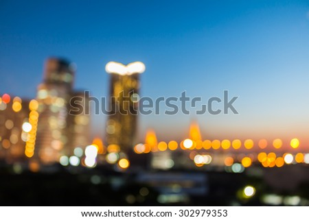 bokeh of city and bridge before sunset background - stock photo