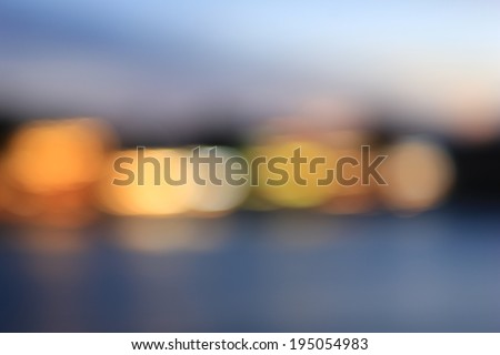 Bokeh of night light. View of cityscape along Chao Praya river, Bangkok. Thailand - stock photo