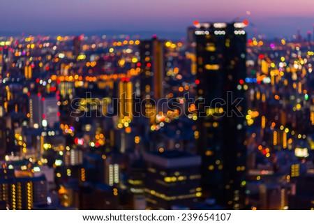 Bokeh of Osaka city light at night - stock photo