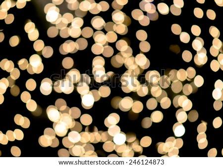 Bokeh on gold yellow defocused light - stock photo