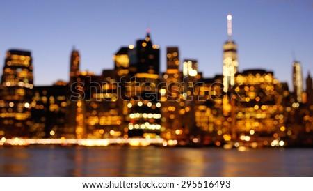 Bokeh photo of Manhattan skyline at dusk panorama  - stock photo