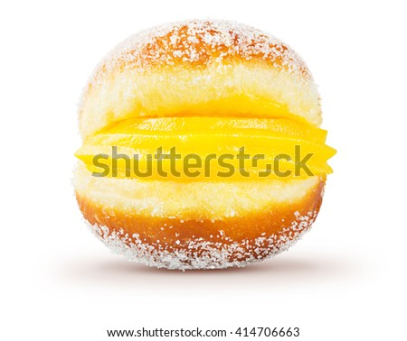 Bola de Berlim, or Berlin Ball, a Portuguese pastry made from a fried doughnut filled with sweet eggy cream and rolled in crunchy sugar on a white background. - stock photo