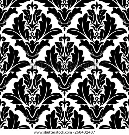 Bold black and white arabesque design with a geometric floral motif in a repeat seamless pattern suitable for damask style fabric or wallpaper - stock photo