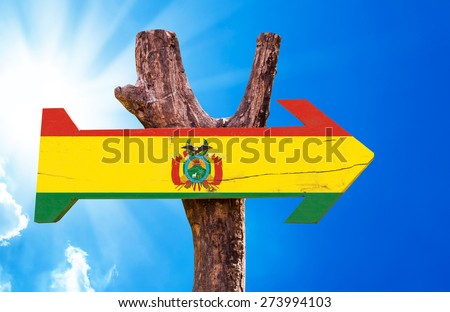 Bolivia Flag wooden sign with sky background - stock photo
