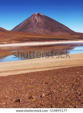 Bolivian mountains and lagoon in the front of view/Uyuni salar flat near Potosi - stock photo
