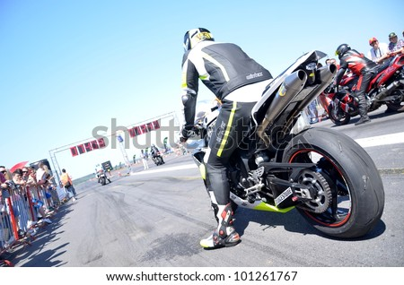 BOLKOVCE, SLOVAKIA - APRIL 28: Unidentified riders during the MAD POWER FEST 2012 1st. round of slovakian drag racing championship, on April 28, 2012 in Bolkovce, Slovakia - stock photo