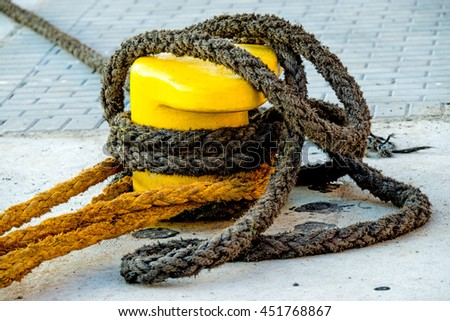 Bollard with mooring lines   - stock photo