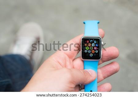 BOLOGNA, ITALY - APR 30, 2015: the Apple Watch. The first wrist device produced by Apple. Screen displays the weather and temperature - stock photo