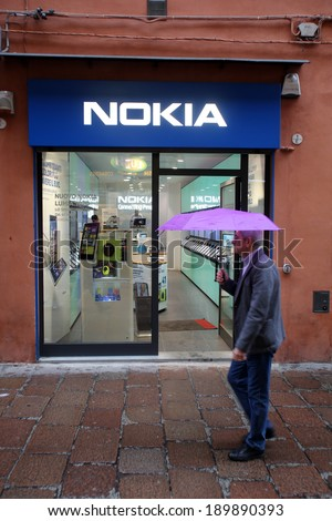 BOLOGNA, ITALY - APRIL 19, 2014: A man walks past a Nokia mobile telephone retail store in Bologna, Italy, on Saturday, April 19, 2014.  - stock photo