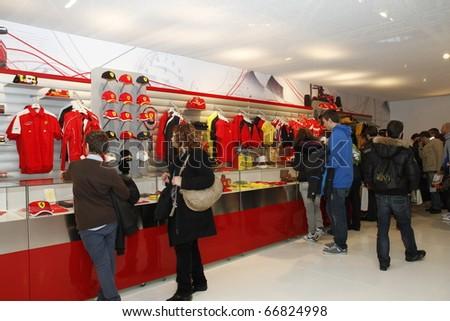 BOLOGNA ITALY-DEC 4: Bologna Motor Show Ferrari gaggets. on December 04, 2010 in Bologna Italy - stock photo