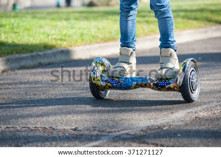 BOLOGNA, ITALY -  JANUARY 31, 2016: Close up of Hoverboard, a rechargeable battery-powered scooter. It consists of two wheels arranged side-by-side, with two small platforms between the wheels. - stock photo