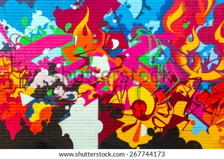 BOLOGNA,ITALY - MARCH 12, 2015: Street art by unidentified artist. Enlivened by murals,  painted figures, graffiti and stencils - stock photo