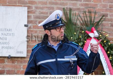 Bologna, Italy - May 2, 2015 : Italian policemen on the street Indipendenza in Bologna, Italy - stock photo