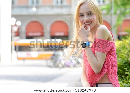 BOLOGNA, ITALY - MAY 17, 2015: one girl wears the Apple Watch. The first wrist device produced by Apple.  - stock photo