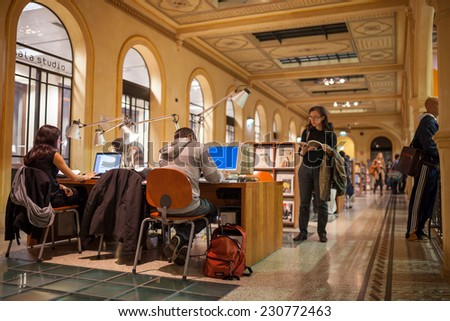 BOLOGNA, ITALY - NOVEMBER 8, 2014 - Hundreds of people enter the Salaborsa, Bologna's public library inaugurated at 2001. It is located at Palazzio d'Accursio. - stock photo