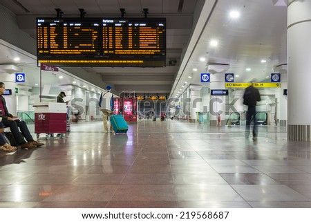 BOLOGNA, ITALY - SEPTEMBER 17, 2014: People rushing inside new station for high-speed trains. The Milanâ Bologna high-speed railway is a railway line that links the cities of Milan and Bologna. - stock photo