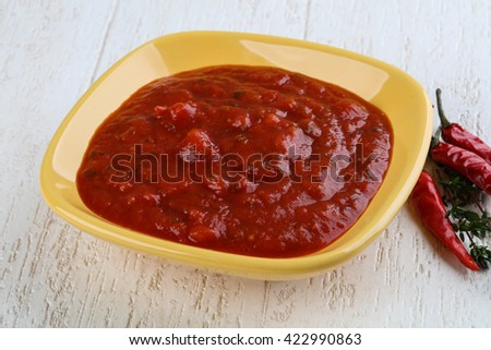 Bolognese sauce ready for cooking on wood background - stock photo