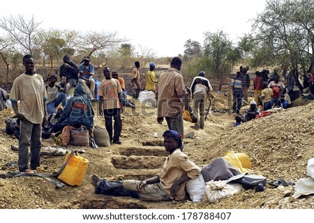 BOLOGO, BURKINA FASO - JANUARY 11: Row of holes to test the gold content of the mine and find a gold vein in a quartz vein, january 11, 2008. - stock photo